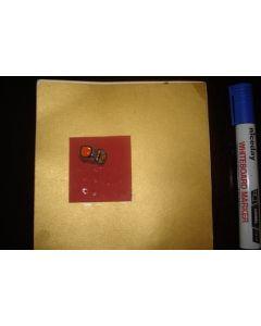 A greetings card with a tiny taxi car football souvenir